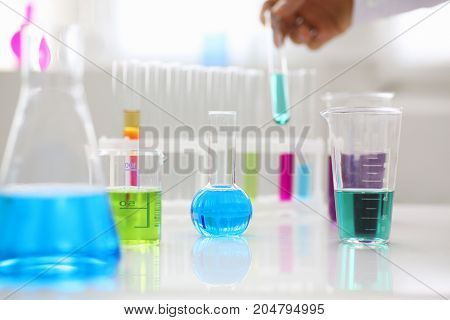 Chemical Industry Bulb With Blue Magenta Pink Liquid Test Tubes Stand On The Table