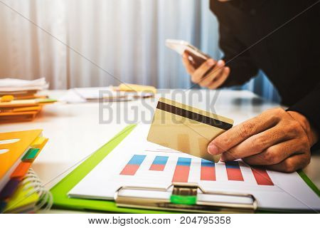 Vat and loan rates calculated by the bank of according to the tax code of the government. Business man asian hard working in the office calculating tax income.