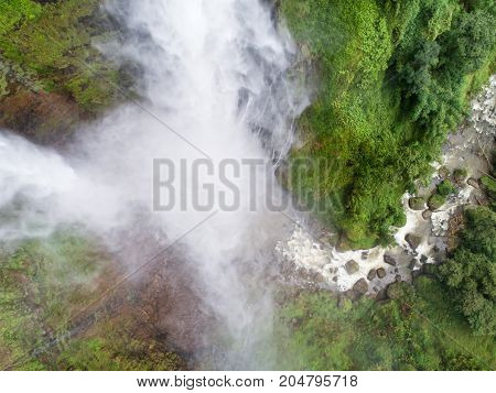 Beautiful waterfall.Tad Fan Waterfall in southern Laos.It is a place to visit the natural beauty.Mountain forest waterfall landscape.Top view Aerial view waterfall amazing nature background Rainforest