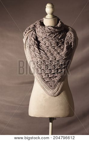 A homemade woolen shawl on the manikin