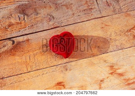 Valentines day red heart on wooden Background. Top view