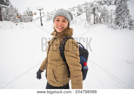 Happy girl on winter nature background. Winter, vacation, weekend and freedom concept