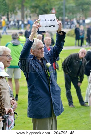 ENSCHEDE THE NETHERLANDS - SEPT 17 2017: An old man is protesting during an anti islam demonstration of Pegida. Pegida is a group of people who are against the islamization of Europe.