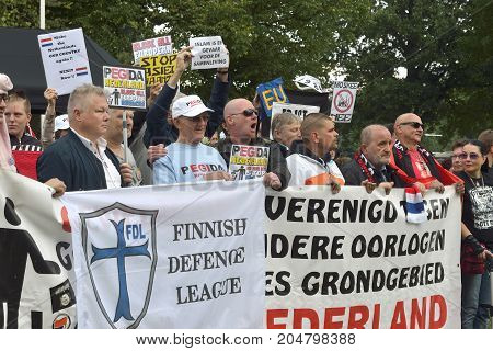 ENSCHEDE THE NETHERLANDS - SEPT 17 2017: People are protesting during an anti islam demonstration of Pegida. Pegida is a group of people who are against the islamization of Europe.