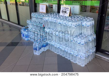 BANGKOK THAILAND 19 SEP 2017: Lot of drinking water in packs with price tag sale in front of family mart convenient store in Bangkok Thailand