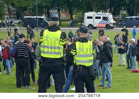 ENSCHEDE THE NETHERLANDS - SEPT 17 2017: Police taking care of security during an anti-islam gathering of Pegida. Pegida is a group of people who are against the islamization of Europe.