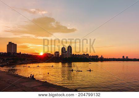 Dnieper quay Obolon district Kiev the capital of Ukraine in the evening sunset light
