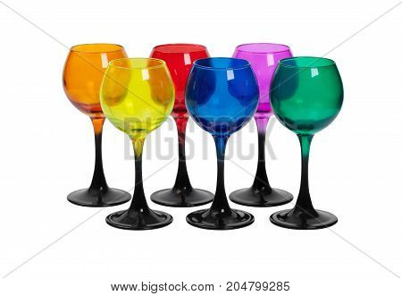 Two rows of glasses made of colored glass on a white background.