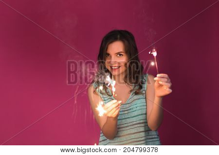 Young woman Sparkler Celebration Happiness Firework Concept.