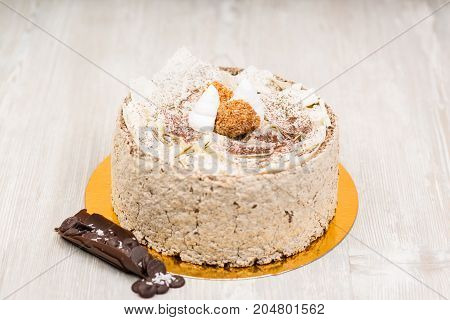 The sponge chocolate cake  on white wooden table