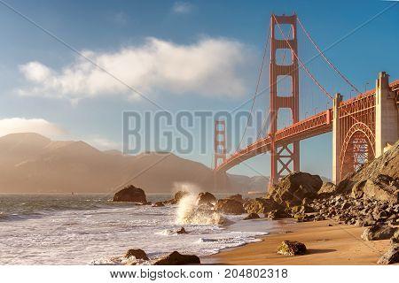 Golden Gate Bridge at Sunset Seen from Marshall Beach, San Francisco.
