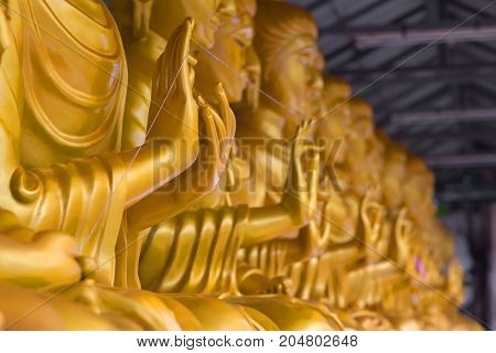The hand of the Buddha from Thai craftsmanship is delicate and beautiful.