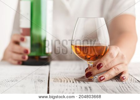 Woman Offering Some Shot Of Alcohol As A Solution To Your Problems