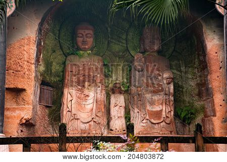 The Buddha statue in Leshan, China. The image of two women in a rock in full growth