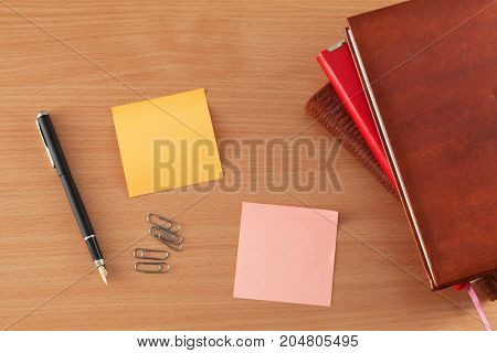 Paper sheets with notes on the table