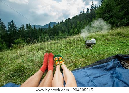 legs of a couples of man and woman outdoors