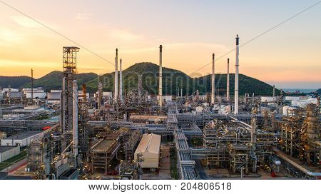 Aerial view Oil refinery.Industrial view at oil refinery plant form industry zone with sunrise and cloudy sky.Oil refinery and Petrochemical plant at dusk Thailand. Oil refinery background sunset.