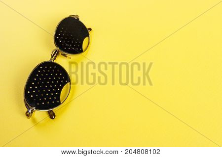 Pinhole glasses on an children eye chart.