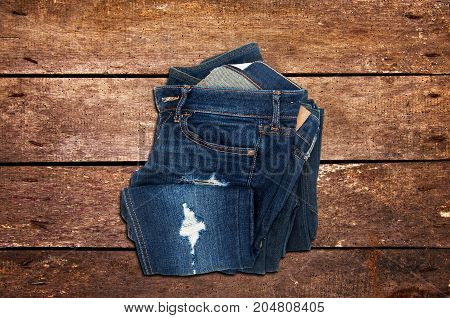 Casual jeans on the wooden background, Top view