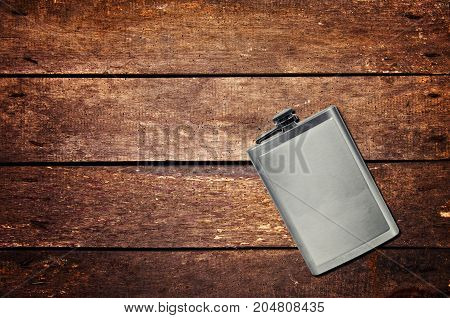 Alcohol flask on the table. Top view