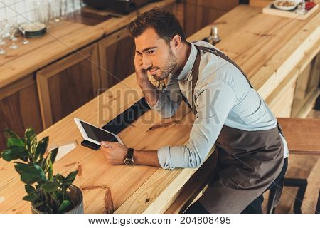 Barista With Tablet In Coffee Shop