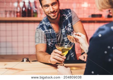 Barman Giving Cocktail To Visitor