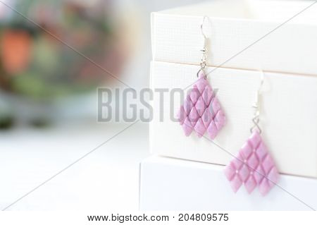 Woven Earrings Made Of Pink Color Beads Close Up