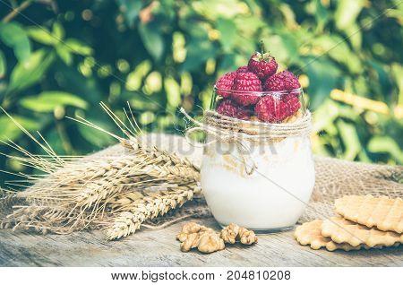 Useful breakfast. Flakes with yoghurt raspberries and nuts.