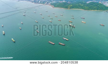 oil tanker gas tanker in the high sea.Refinery Industry cargo ship. top view aerial view Thailand in import export LPG oil refinery Logistics and transportation with working crane bridge in harbor