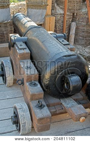 Old ship cannon on a coastal position