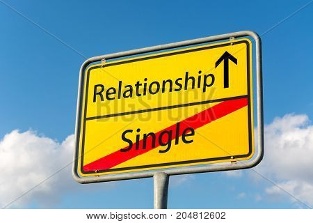 Yellow Street Sign With A Relationship Ahead Leaving Single Status Behind