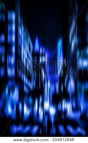 Abstract blurred image of Manhattan at night. Illumination and night lights of New York City. Intentional motion blur