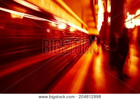 Metro Train with motion blur effect. Intentional color shift in orange-red tone