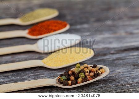 Spices And Herbs On Old Kitchen Table.