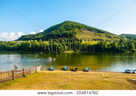 Summer at Bystricka dam with small boat and pedal booms, Moravia, Czech Republic.
