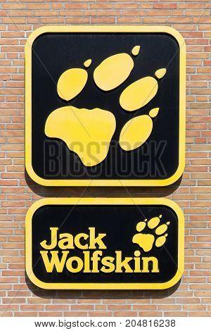 Hvide Sande, Denmark - August 1, 2017: Jack Wolfskin logo on a wall. Jack Wolfskin is a major German producer of outdoor wear and equipment headquartered in Idstein