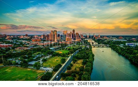 Golden Hour Colors across the sky above Downtown Austin Texas Cityscape Skyline View high above Town Lake Texas Hill Country Landscape