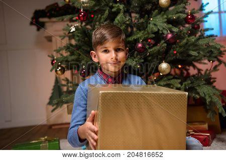 Child Holding Christmas Present