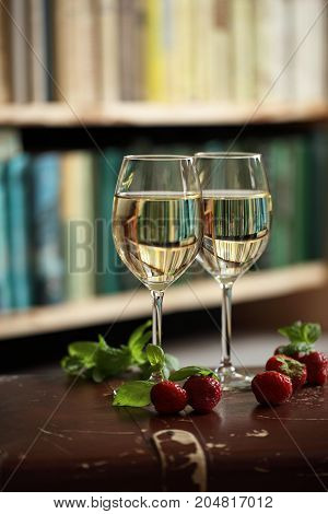 Wineglasses With White Wine Decorated With Strawberry And Mint
