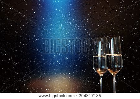 Champagne with starry sky and blue spotlight for a new year decoration