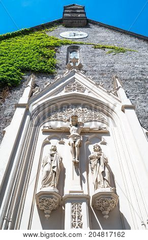 Austria Salzburg sacred sculptures on the rear facade of the Blasius church in the old town
