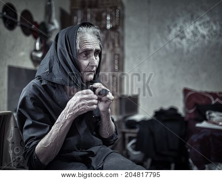 Closeup of an expressive elderly woman in her home