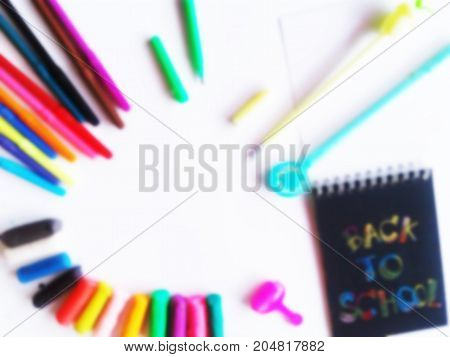 School set with back to school inscription notebooks on light wooden background. Pencil eraser pencil clay. on white background. text
