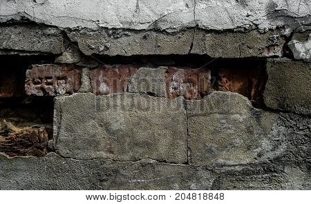 Brick wall and old plaster. Brick and concrete. Brick wall background. Old brick wall. Old brickwork.