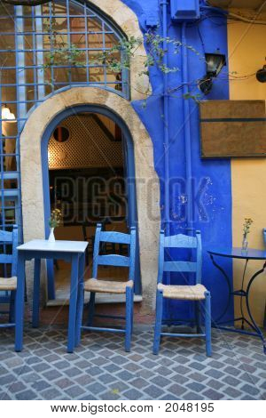 A typical tourist area Greek taverna in the popular Venetian old town part of Hania Crete. poster