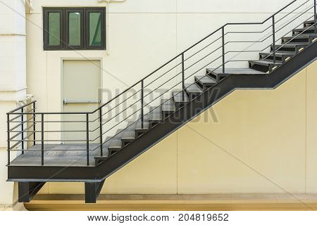 Stair For Fire Escape With The Steel Railing And Ladder