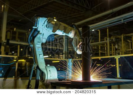 Industrial robot is welding assembly automotive part in car factory