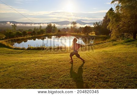 boy runs on the morning dew. the child rejoices at the coming of a new day. Copy space for your text