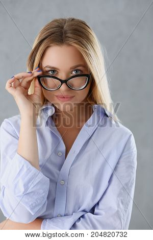 Portrait Of A Sexy Woman In A Man's Shirt Wearing Glasses