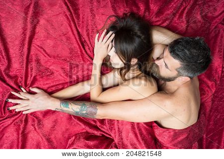 Man And Woman With Half Covered Bodies Hug